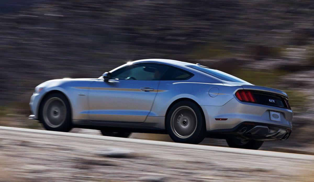 rear 3/4, running, silver